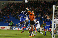 Marco Silvestri , the Leeds Utd goalkeeper punches clear from Cardiff's Bruno Ecuele Manga.,Skybet football league championship match, Cardiff city v Leeds Utd at the Cardiff city stadium in Cardiff, South Wales on Tuesday 8th March 2016.<br /> pic by Andrew Orchard, Andrew Orchard sports photography.