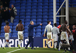 Cardiff City manager Neil Warnock (centre) and his players acknowledge their travelling fans, after the Premier League match at Selhurst Park, south east London.