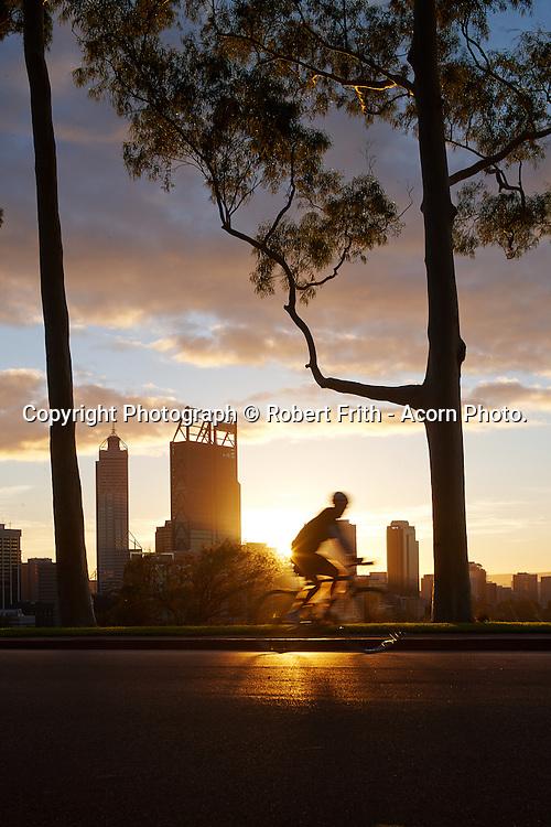Cyclist at dawn on Fraser Avenue overlooking Perth CBD Perth Region