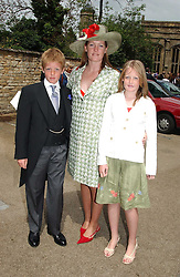 Left to right, EARL GROSVENOR, LADY TAMARA VAN CUTSEM  and LADY VIOLA GROSVENOR at the wedding of Hugh van Cutsem to Rose Astor in Burford, Oxfordshire on 4th June 2005.<br />
