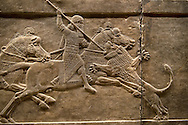 Assyrian relief sculpture panel of Ashurnasirpal lion hunting.  From Nineveh  North Palace, Iraq,  668-627 B.C.  British Museum Assyrian  Archaeological exhibit no ME 124876. .<br /> <br /> If you prefer to buy from our ALAMY PHOTO LIBRARY  Collection visit : https://www.alamy.com/portfolio/paul-williams-funkystock/ancient-assyria-antiquities.html  Refine search by adding background colour, place, subject, museum etc into the LOWER SEARCH WITHIN GALLERY box to <br /> <br /> Visit our ANCIENT ASSYRIAN PHOTO COLLECTIONS for more photos to download or buy as wall art prints https://funkystock.photoshelter.com/gallery-collection/Ancient-Assyrian-Art-Artefacts-Antiquities-Historic-Sites-Pictures-Images-of/C0000cjRqQyJjLag