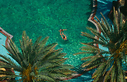 Aerial view of a adult and child playing in a Miami Beach hotel pool, on 15th May 1996, in Miami Beach, Florida, USA.