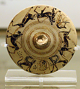 Lid from a pyxis (cosmetic box) with animals and a cuirass. Made in Corinth about 650-630 BC. From the temple of Artemis at Ephesus