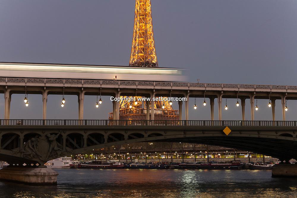 France. Paris. the Eiffel tower and Bir hakeim bridge on the Seine river at sunset / Paris le pont de Bir Hakeim sur la Seine et la tour Eiffel. Before to publish an image of the Eiffel tower lighting you should contact SETE; Mr Dieu at +33144112399 particularly for advertinsing.