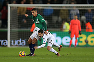 Roque Mesa of Swansea city is fouled by Jake Livermore of West Bromwich Albion. Premier league match, Swansea city v West Bromwich Albion at the Liberty Stadium in Swansea, South Wales on Saturday 9th December 2017.<br /> pic by  Andrew Orchard, Andrew Orchard sports photography.