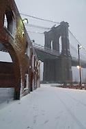 New York. Brooklyn under the snow . under Brooklyn bridge . the old tobacco factory  New York  Usa /  anciens entrepots de tabac renoves sous le pont de Brooklyn .  New York