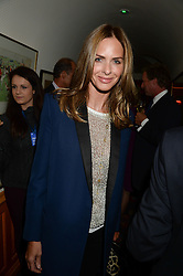 TRINNY WOODALL at an exhibition of the 50 best party pictures from Tatler from the past 50 years, held at Annabel's, Berkeley Square, London on 9th September 2013.