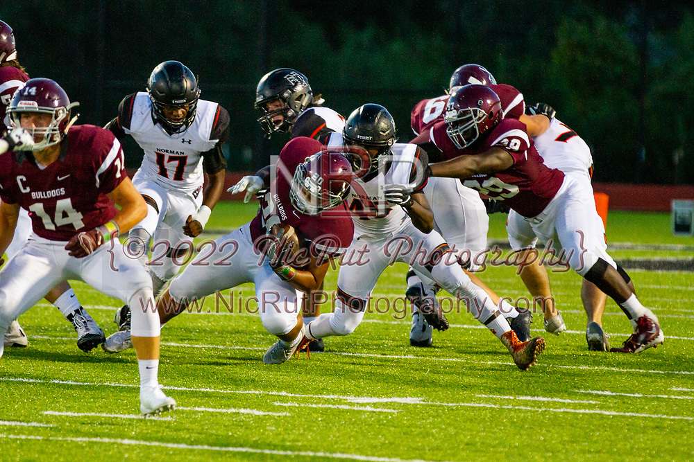 Norman's Tevin Randle tackles Edmond's Mason Williams during the game in Edmond on Friday, October 05, 2018.