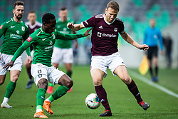 Eric Boakye of NK Olimpija and Ales Mertelj of NK Triglav  during football match between NK Olimpija Ljubljana and NK Triglav Kranj in Round #22 of Prva liga Telekom Slovenije 2019/20, 25 February, 2020 in Stadium Stozice, Ljubljana, Slovenia. Photo By Grega Valancic / Sportida