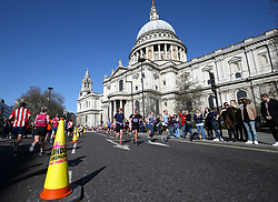Competitors pass St. Pauls Cathedral during the 2019 London Landmarks Half Marathon.