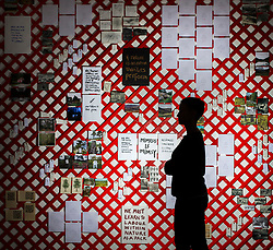 © Licensed to London News Pictures. 27/04/2018. Wakefield UK. Kerry Chase looks at the latticework wall of photos & words by Alec Finlay at the Yorkshire Sculpture Park this morning. The art work features in a new exhibition at the park which showcases the radical & vital work of arts & environment charity Common Ground. Photo credit: Andrew McCaren/LNP
