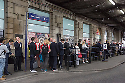 © Licensed to London News Pictures. 06/08/2015. London, UK. People queue for taxis at Waterloo station in London. A tube strike today has closed the TfL London Underground network as members of four unions take industrial action for the second time in a month because of a deadlocked dispute over plans to launch a new all-night tube train service next month. Extra busses have been laid on to help commuters get to work. Photo credit : Vickie Flores/LNP