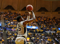 Jan 15, 2018; Morgantown, WV, USA; West Virginia Mountaineers forward Lamont West (15) shoots a three pointer during the second half against the Kansas Jayhawks at WVU Coliseum. Mandatory Credit: Ben Queen-USA TODAY Sports