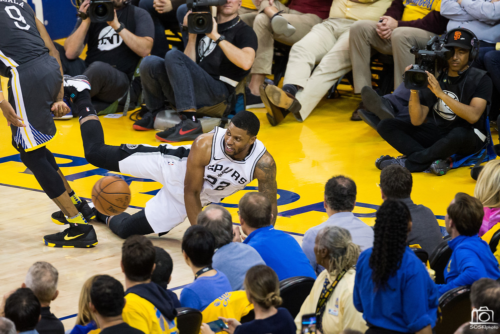San Antonio Spurs forward Rudy Gay (22) dives to save the ball during Game 2 of the Western Conference Quarterfinals against the Golden State Warriors at Oracle Arena in Oakland, Calif., on April 16, 2018. (Stan Olszewski/Special to S.F. Examiner)