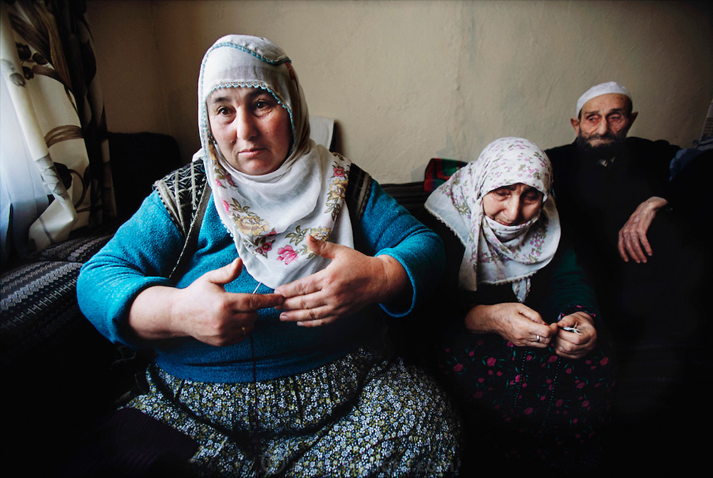 Her parents listen as Safiye Çinar talks about the origins of her extended family. Golden Horn (or Haliç) area, Istanbul, Turkey.