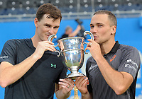 Tennis - 2017 Aegon Championships [Queen's Club Championship] - Day Seven, Sunday<br /> <br /> Men's Doubles, Final<br /> Jamie Murray [GBR] and Bruno Soares [Bra ]vs. Julien Benneteau [Fra] ans Edouard Roger - Vasselin [Fra]<br /> <br /> Jamie Murray [GBR] and Bruno Soares kiss the trophy on Centre Court <br /> <br /> COLORSPORT/ANDREW COWIE