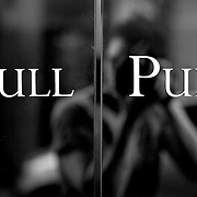 Pull Pull glass door reflection, London, England (September 2007)