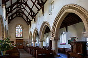 Decorated Norman arches in nave of Great Bedwyn church, Wiltshire, England, UK