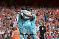 Cheikhou Kouyate of West Ham United celebrates after scoring his first goal his teams first goal of the game to make it 0-1 with teammates Dimitri Payet of West Ham United and Reece Oxford of West Ham United. Barclays Premier League, Arsenal v West Ham Utd at the Emirates Stadium in London on Sunday 9th August 2015.<br /> pic by John Patrick Fletcher, Andrew Orchard sports photography.