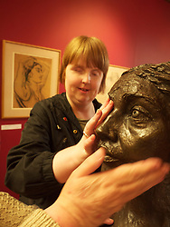 Visually impaired people at sculpture exhibition at Walsall Art Gallery