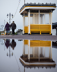 © Licensed to London News Pictures. 29/09/2016. Portsmouth, Hampshire, UK.  A couple walking on Southsea Promenade this morning, 29th September 2016. Wet and windy weather hits the south coast this morning following days of warm sunny weather. Photo credit: Rob Arnold/LNP