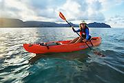 Woman kayaking Kaneohe Bay, Oahu, Hawaii