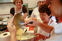 """Lenotre Ecole Culinaire, Paris,..short course - """"Return to the Market"""" with Chef Jacky Legras..adding the mascarpone to the whipped cream for the dessert..photo by Owen Franken for the NY Times..July 12, 2007......."""