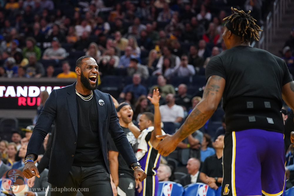 February 27, 2020; San Francisco, California, USA; Los Angeles Lakers forward LeBron James (23) celebrates with center Dwight Howard (39) against the Golden State Warriors during the third quarter at Chase Center.