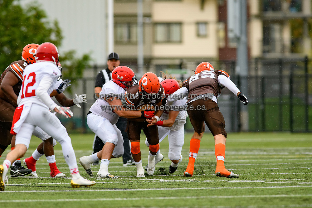 CHILLIWACK, BC - SEPTEMBER 11: Malcolm Miller #3 of Okanagan Sun is tackled by the Westshore Rebels at Exhibition Stadium in Chilliwack, BC, Canada. (Photo by Marissa Baecker/Shoot the Breeze)