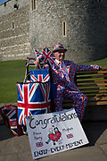 A royalists rests on a bench outside Windsor Castle as the royal town gets ready for the royal wedding between the Prince and his American fiance, on 14th May 2018, in London, England.