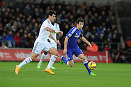 Oscar of Chelsea breaks away from Nelson Oliveira of Swansea city. Barclays Premier League match, Swansea city v Chelsea at the Liberty Stadium in Swansea, South Wales on Saturday 17th Jan 2015.<br /> pic by Andrew Orchard, Andrew Orchard sports photography.