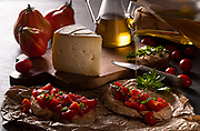 Country brunch based on sweet cheese and bruschetta with tomato, basil and extra virgin olive oil