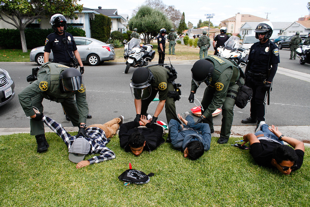 Sheriff in riot gear come in and arrest all four Anti-Trump protestors on May 25, 2016 in Anaheim, California.