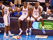 June 2, 2012; Oklahoma City, OK, USA; Oklahoma City Thunder guard James Harden (13) forward Serge Ibaka (9) and center Kendrick Perkins wait during a time out during the second half of a playoff game against the San Antonio Spurs at Chesapeake Energy Arena.  Thunder defeated the Spurs 109-103 Mandatory Credit: Beth Hall-US PRESSWIRE