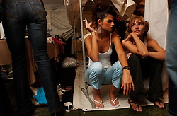 Models wait backstage before the opening night of Fashion Week in Caracas, Venezuela..  Throughout the week Venezuelan designers will show their new collections; there is also a night featuring Italian designers and BCBG will be featured on a different night.  Fashion and looking good are top priorities in Venezuela, where there is a general culture of beauty.  It is a culture that permeates all walks of life and covers the country like a blanket. Girls enter beauty pageants as toddlers and young women and men get plastic surgery as teens.  Venezuela is a country where thongs and short skirts are the norm, cleavage awaits around every corner and metrosexual men abound.