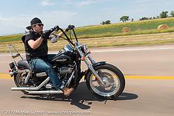 Robert Lodge of Denver, CO rides back to Sturgis after the annual Michael Lichter - Sugar Bear Ride hosted by Jay Allen with the Easyriders Saloon during the Sturgis Black Hills Motorcycle Rally. SD, USA. Sunday, August 3, 2014. Photography ©2014 Michael Lichter.