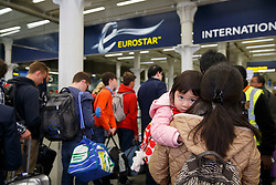 © licensed to London News Pictures. London, UK 18/04/2014. People waiting for Eurostar trains at St Pancras station central in London on April 18, 2014 ahead of Easter holiday. The services disrupted by a fatality near the French city of Lille and a car-carrying Eurotunnel Shuttle failed in the Channel Tunnel on the day before. Photo credit: Tolga Akmen/LNP