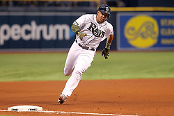 May 26, 2018 - St. Petersburg, FL, U.S. - ST. PETERSBURG, FL - MAY 26: Carlos Gomez (27) of the Rays hustles over to third base before getting himself into a run down during the MLB regular season game between the Baltimore Orioles and the Tampa Bay Rays on May 26, 2018, at Tropicana Field in St. Petersburg, FL. (Photo by Cliff Welch/Icon Sportswire) (Credit Image: © Cliff Welch/Icon SMI via ZUMA Press)