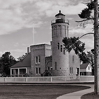 """""""Old Mackinac Point Lighthouse""""<br /> <br /> The historic and beautiful Old Mackinac Point Lighthouse located in Mackinaw City, over looking the Mackinac Straights, and Mackinac Bridge! A beautiful black and white image of a lighthouse!<br /> <br /> <br /> Black and White images by Rachel Cohen"""