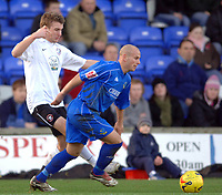Photo: Paul Greenwood.<br />Macclesfield Town v Hereford United. Coca Cola League 2. 20/01/2007. Macclesfield's Adam Murray, right, gets the better of Hereford's Andy Williams