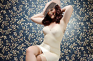 Vintage Corset and hat, model with sexy smile and classy timeless pin up look