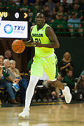 WACO, TX - MARCH 5: Taurean Prince #21 of the Baylor Bears brings the ball up court against the West Virginia Mountaineers on March 5, 2016 at the Ferrell Center in Waco, Texas.  (Photo by Cooper Neill/Getty Images) *** Local Caption *** Taurean Prince