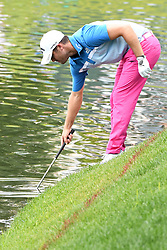 June 25, 2017 - Cromwell, Connecticut, U.S - Wesley Bryan reaches into the water for his ball on the 17th hole during the final round of the Travelers Championship at TPC River Highlands in Cromwell, Connecticut. (Credit Image: © Brian Ciancio via ZUMA Wire)