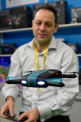 © Licensed to London News Pictures. 24/01/2016. London, UK. Richard Mire, of RDM Creations, demonstrates a pocket drone at the opening day of the Toy Fair 2017, taking place at Kensington Olympia.  The trade show brings together many of the leading toy manufacturers and distributors and offers a chance for buyers to see the latest toys in preparation for Christmas. Photo credit : Stephen Chung/LNP