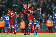 Liverpool Manager Jurgen Klopp lifts up Alex Oxlade-Chamberlain of Liverpool after the game. Premier League match, Liverpool v Leicester City at the Anfield stadium in Liverpool, Merseyside on Saturday 30th December 2017.<br /> pic by Chris Stading, Andrew Orchard sports photography.