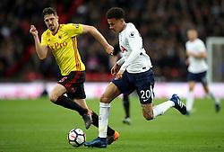 Watford's Sebastian Prodl (left) and Tottenham Hotspur's Dele Alli battle for the ball during the Premier League match at Wembley Stadium. London.