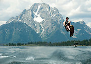 PRICE CHAMBERS / NEWS&GUIDE<br /> Shayne Hansenjumps the wake of his powerboat on an Air Chair, also known as a Sky Ski, on Jackson Lake recently. The largest lake in Grand Teton National Park, Jackson Lake attracts speed freaks looking for a shot of adrenaline, families on pontoon boats exploring the huge reservoir's many coves and inlets, and swimmers and picnickers enjoying its cool waters and remote beaches.