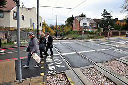 © Licensed to London News Pictures. 15/11/2016<br /> A group of women walk over empty rail tracks near the scene of a tram derailment at Sandilands Station in Croydon. Tomorrow marks one week since the crash in which seven people were killed and more than 50 people were injured when the carriages flipped over. Photo credit :Grant Falvey/LNP