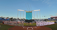The Kansas City Royals and the Los Angeles Angels line the base lines during the playing of the National Anthem before game three of the 2014 ALDS baseball playoff game at Kauffman Stadium.