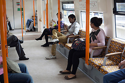 © licensed to London News Pictures. London, UK 31/07/2012. People on an Overground train while the central line being operating with severe delays and temporarily losing its connection to Stratford (Olympic Park) on 31/07/12. Photo credit: Tolga Akmen/LNP